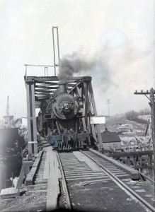 Locomotive as seen coming through a railroad bridge towards the camera