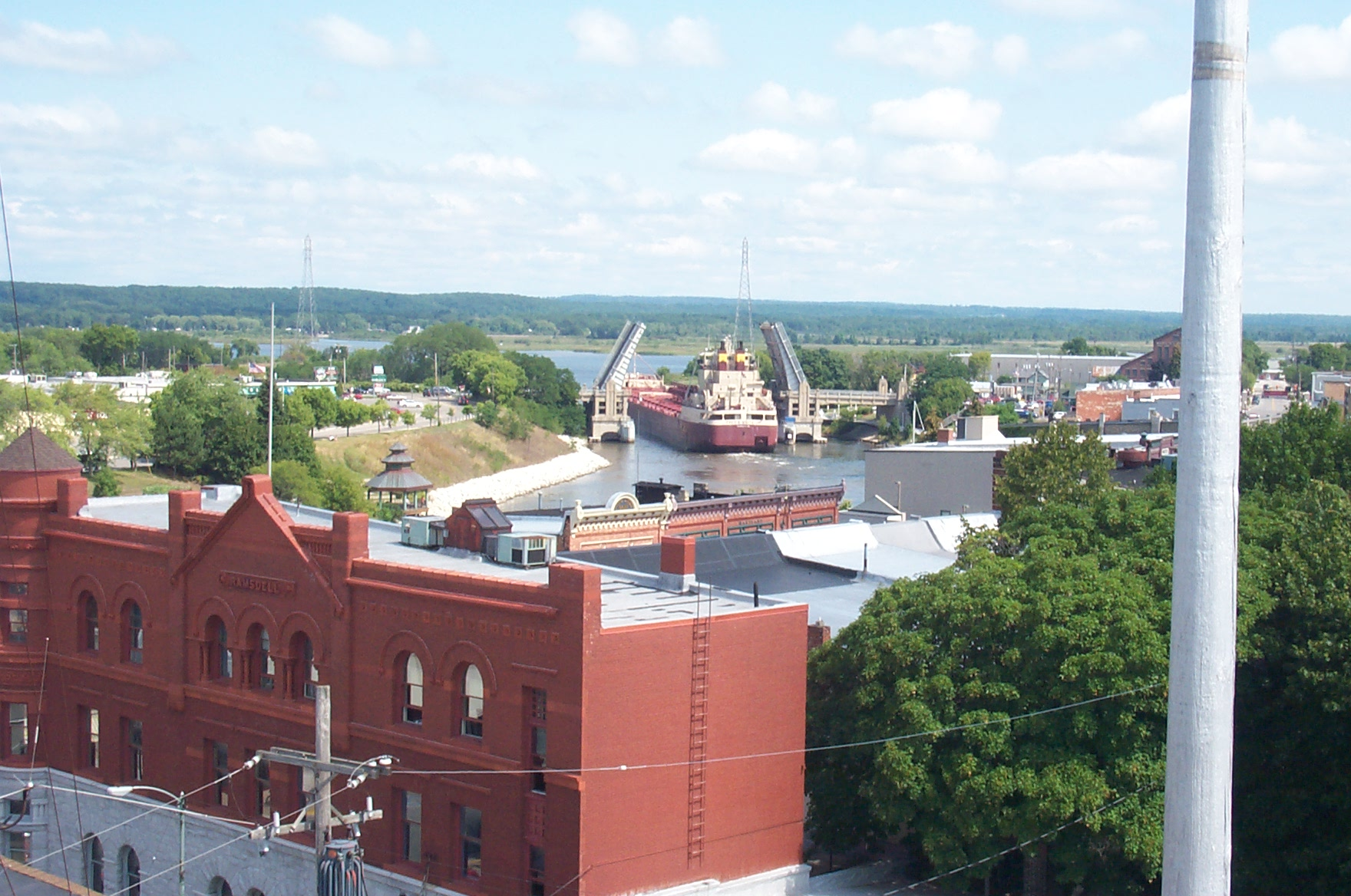 Photo taken from the roof of City Hall that shows the Great Lakes Freighter Fred White as it passes through Memorial Bridge the Ramsdell Building is seen in the foreground