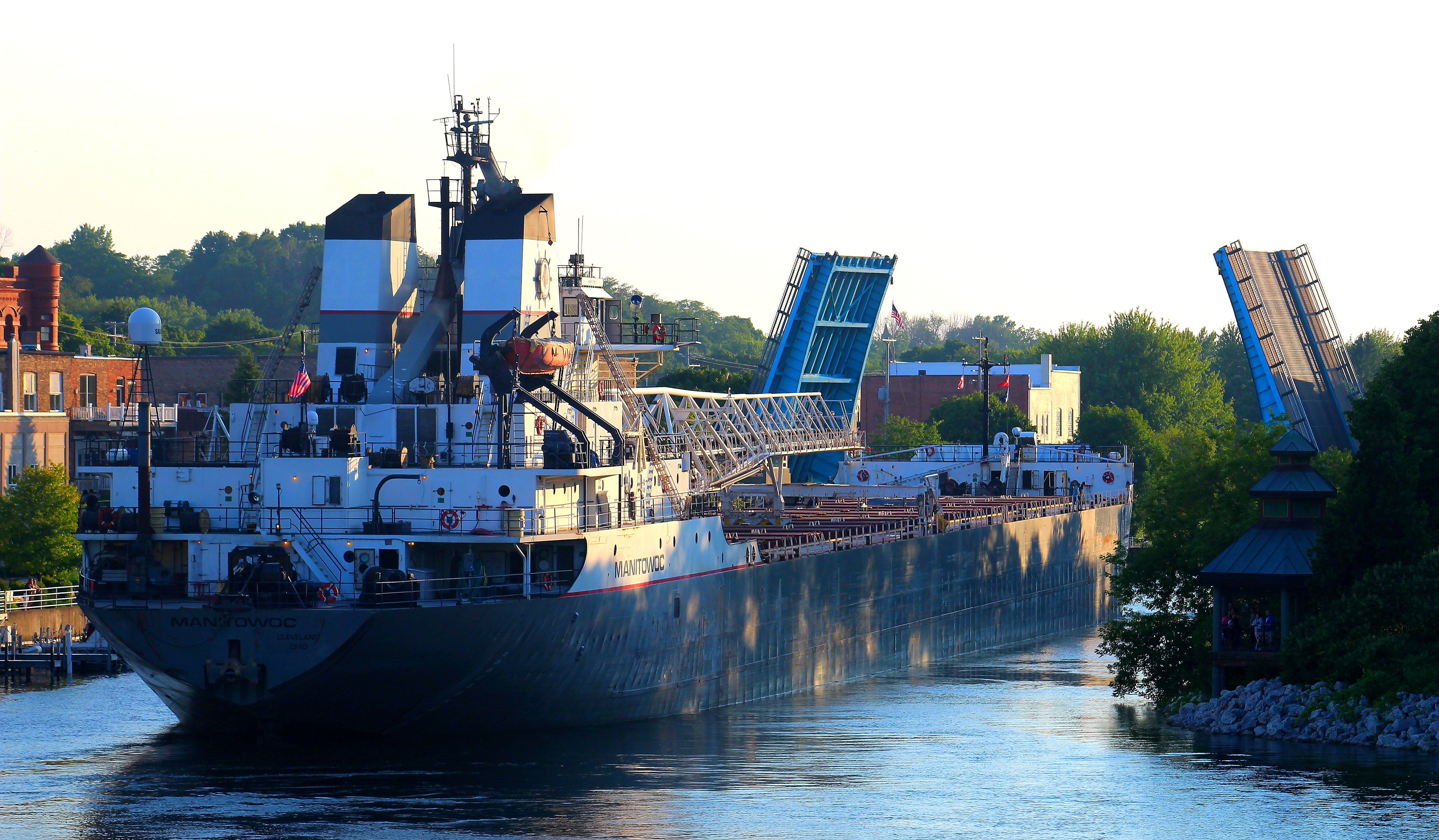 Great Lakes Freighter Manitowoc going through Maple Street Bridge on a sunny day
