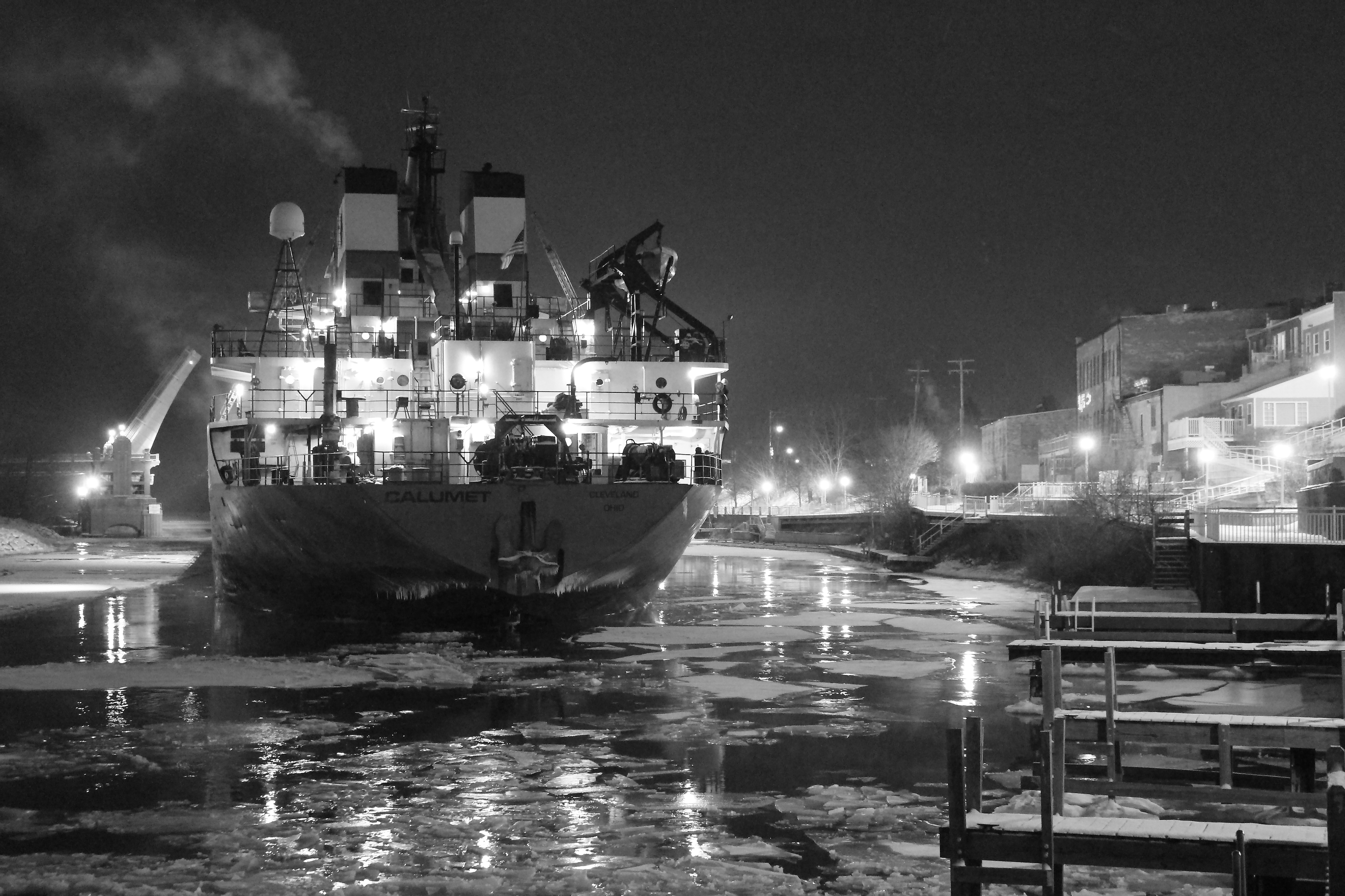Black and White photo of a Freighter In the Manistee River Channel at night
