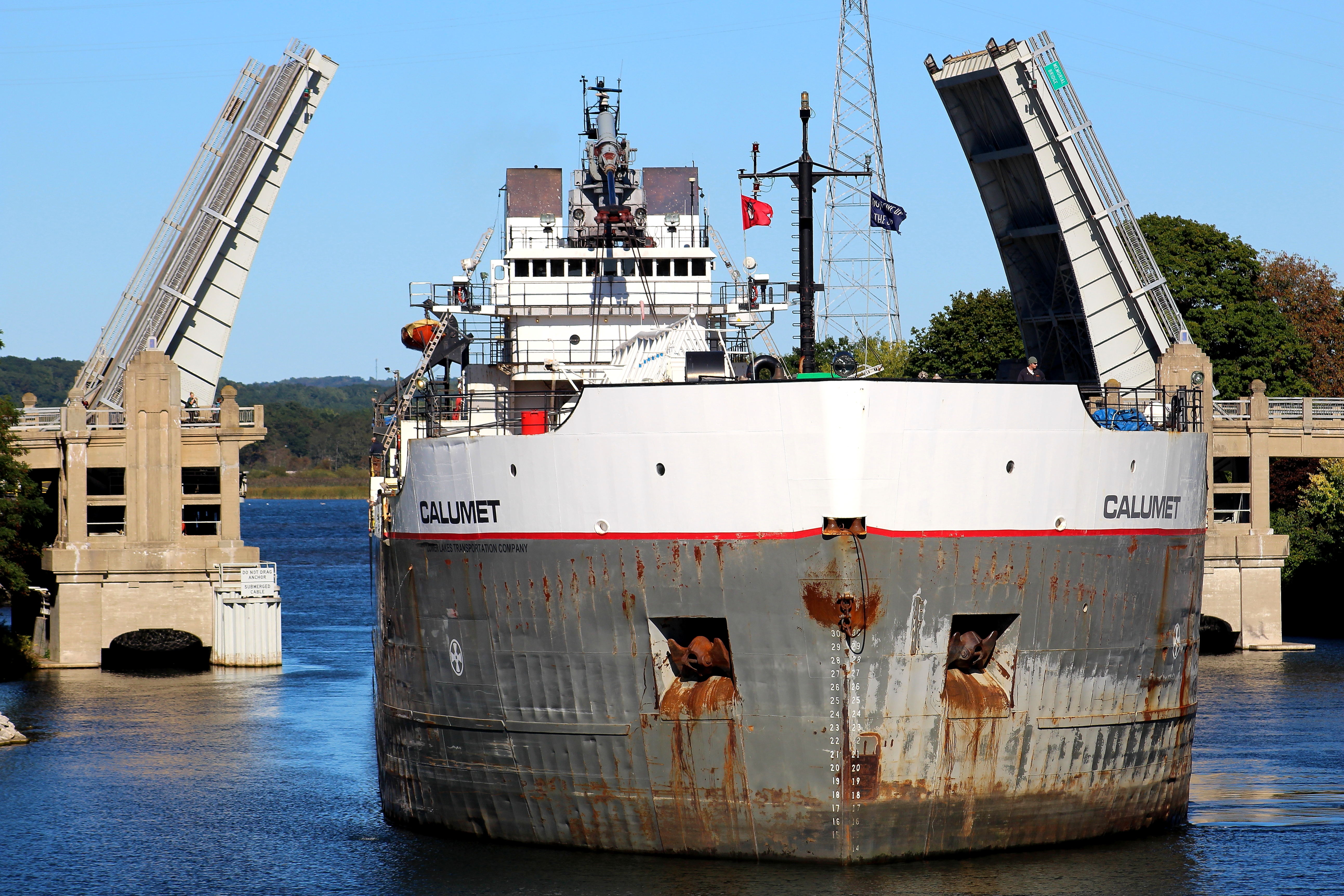 Freighter Calument going through the US 31 Bridge in the Manistee River Channel
