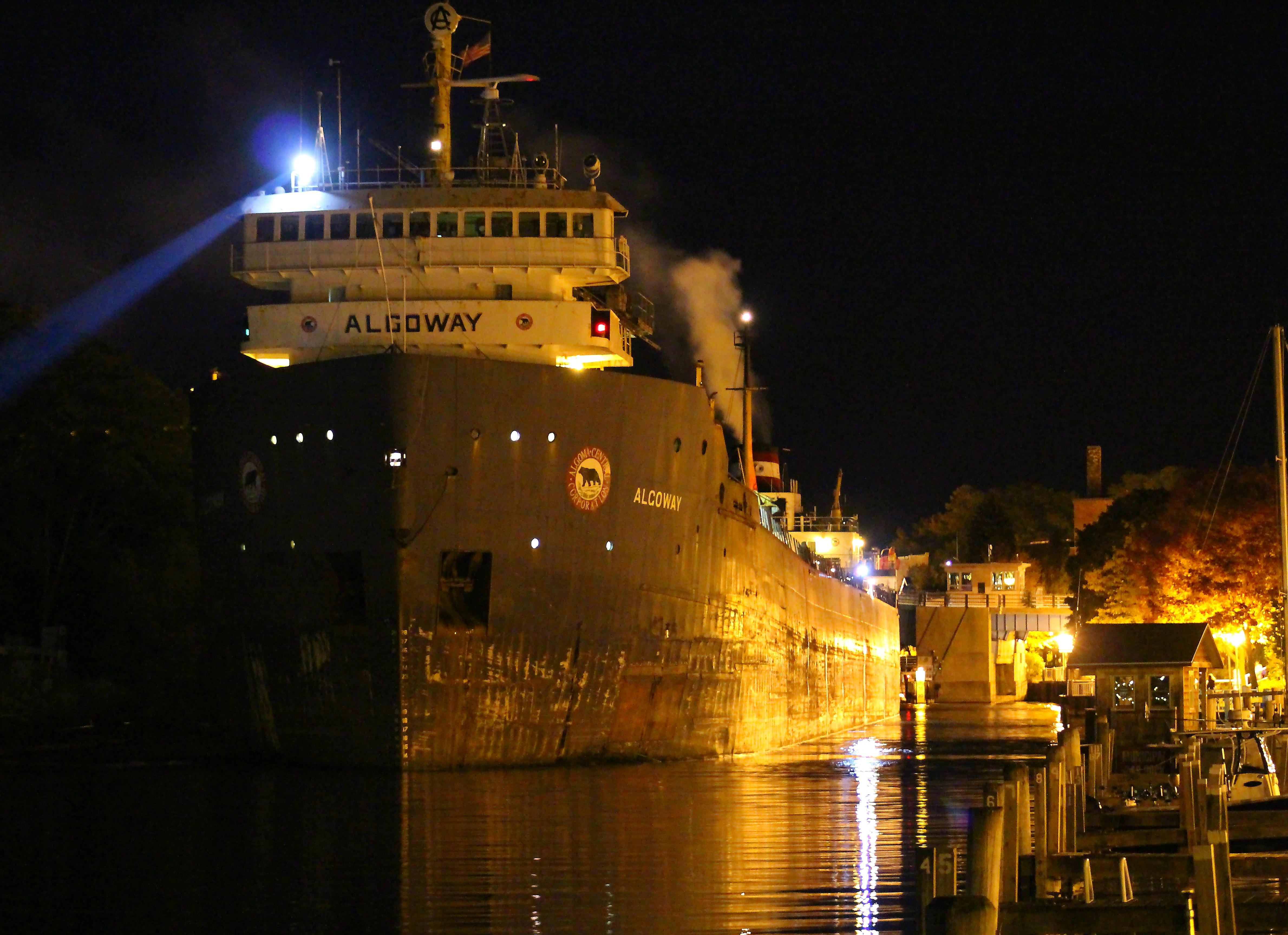 Freighter Algoway maneuvering the Manistee River Channel at night