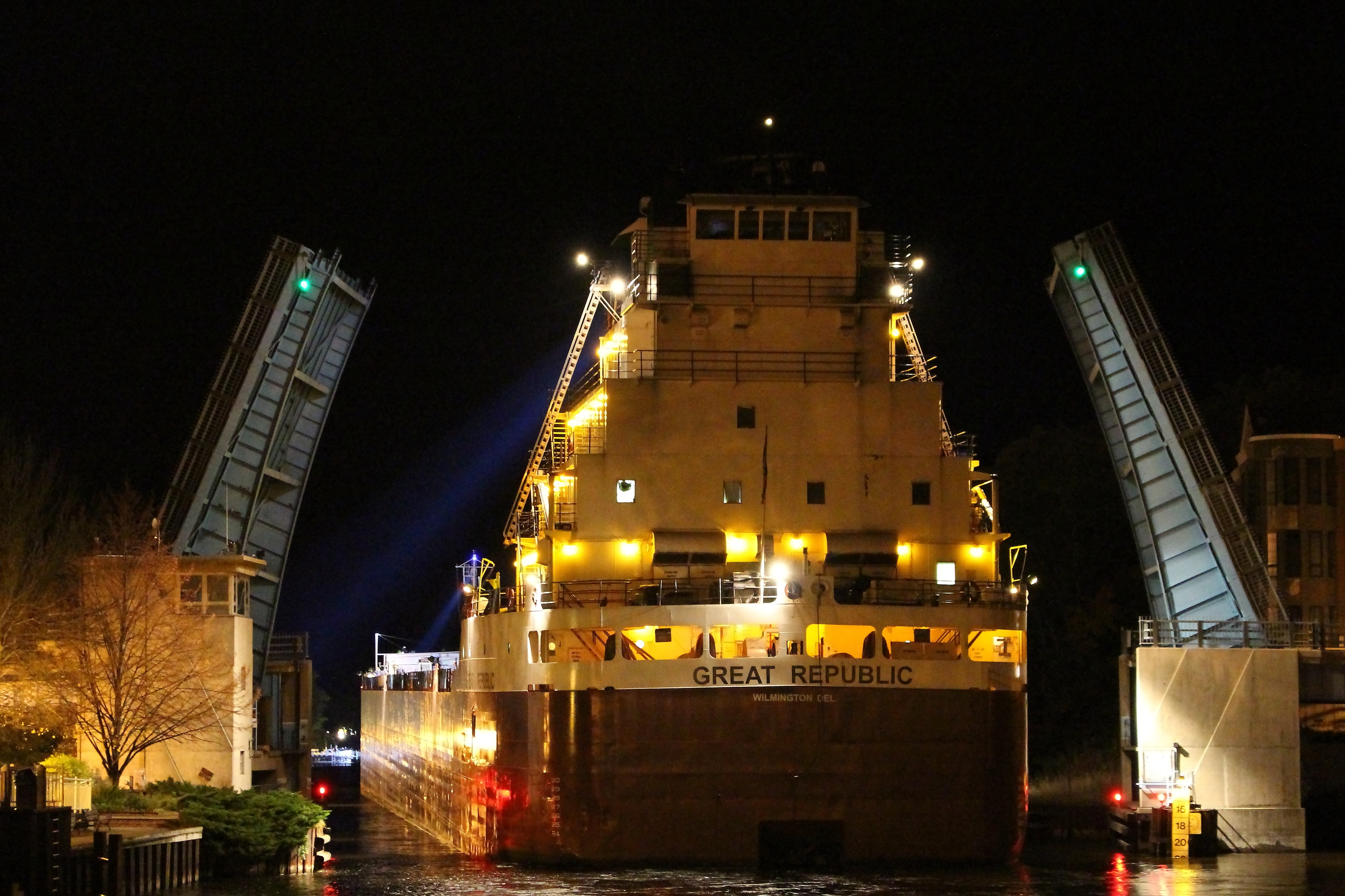 Freighter Great Republic exiting the Manistee River Channel at Maple Street Bridge at night