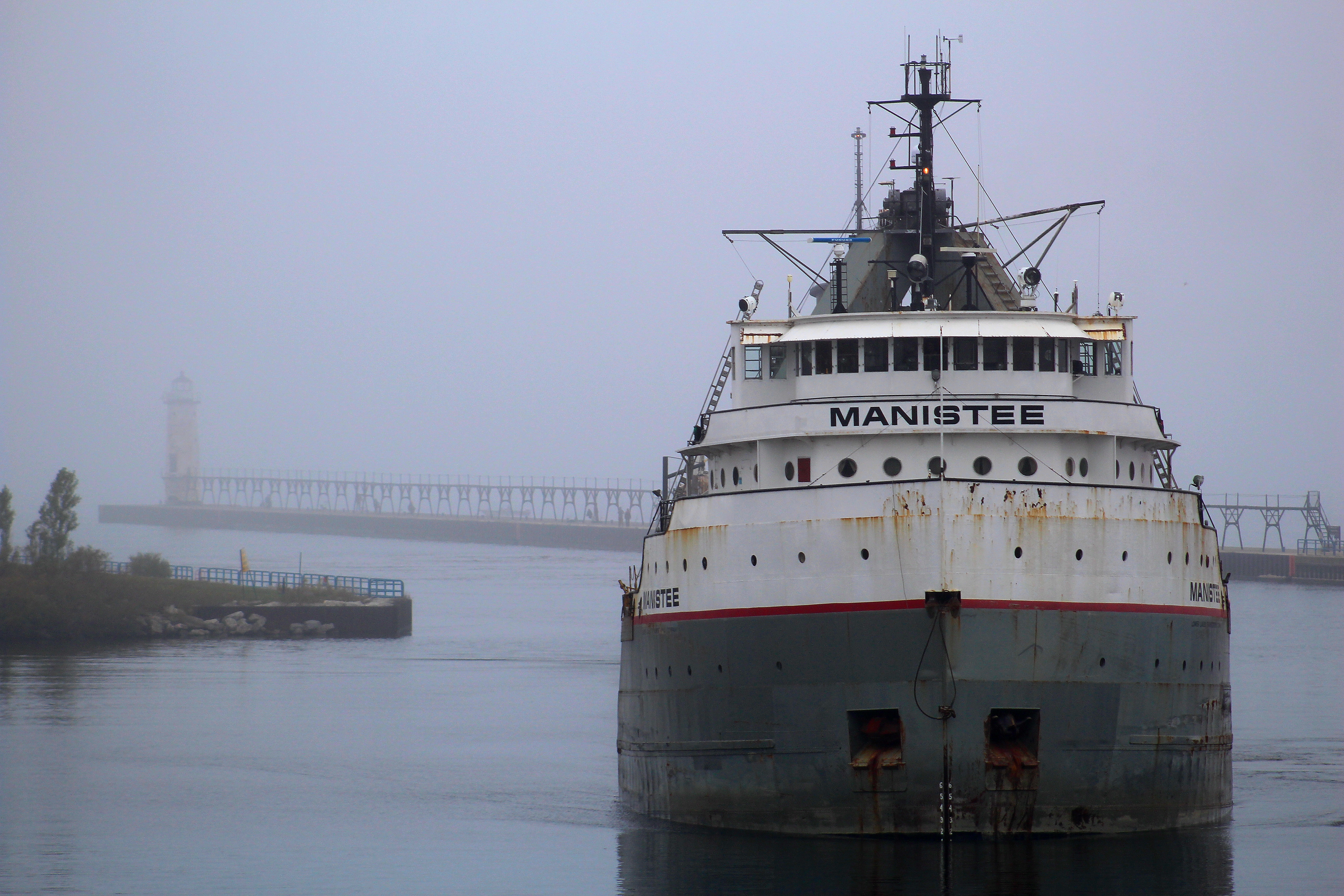 Freighter Manistee entering the Manistee River channel on a foggy day