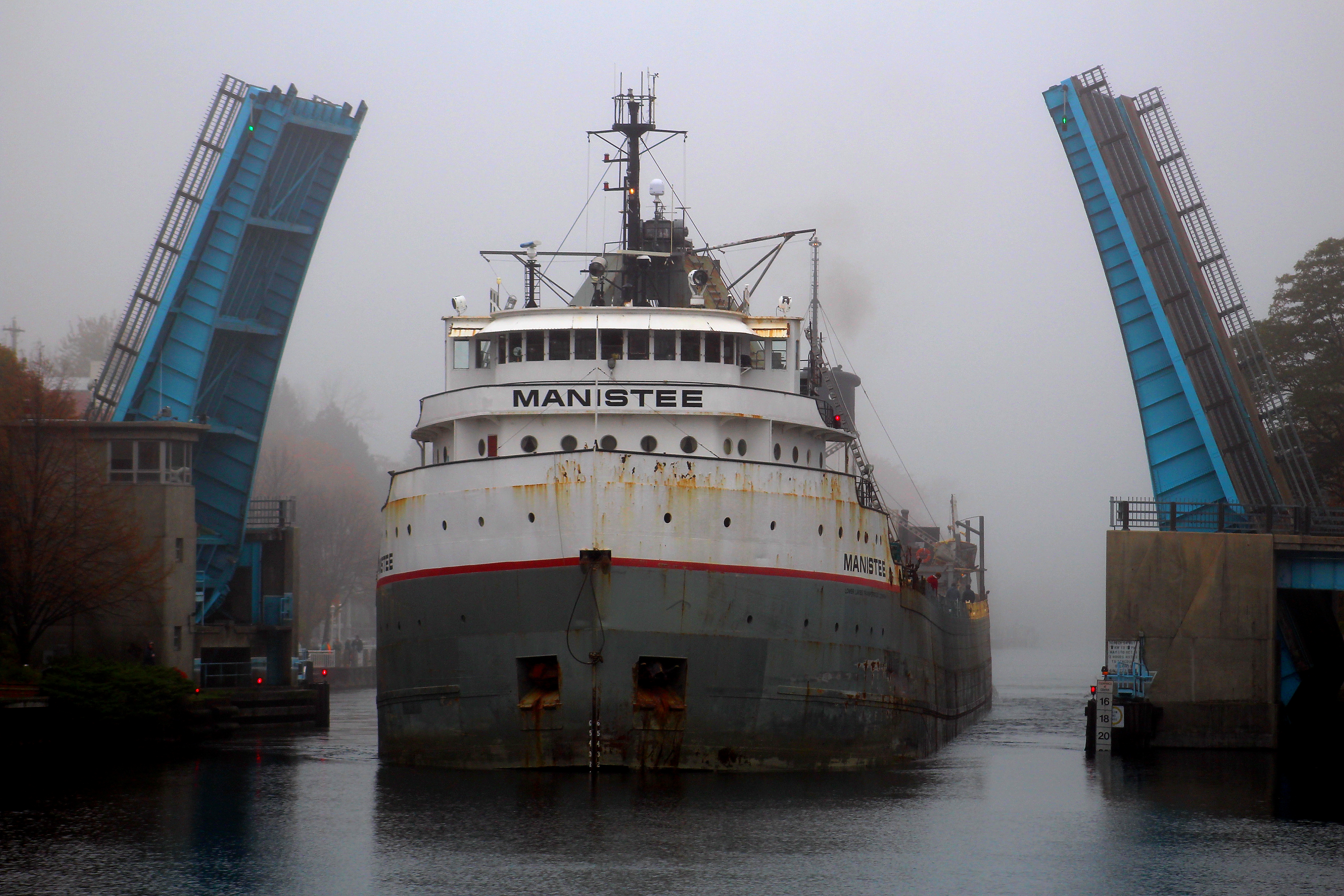 Freighter Manistee  on  a misty morning going through Maple Street Bridge in the Manistee River Channel