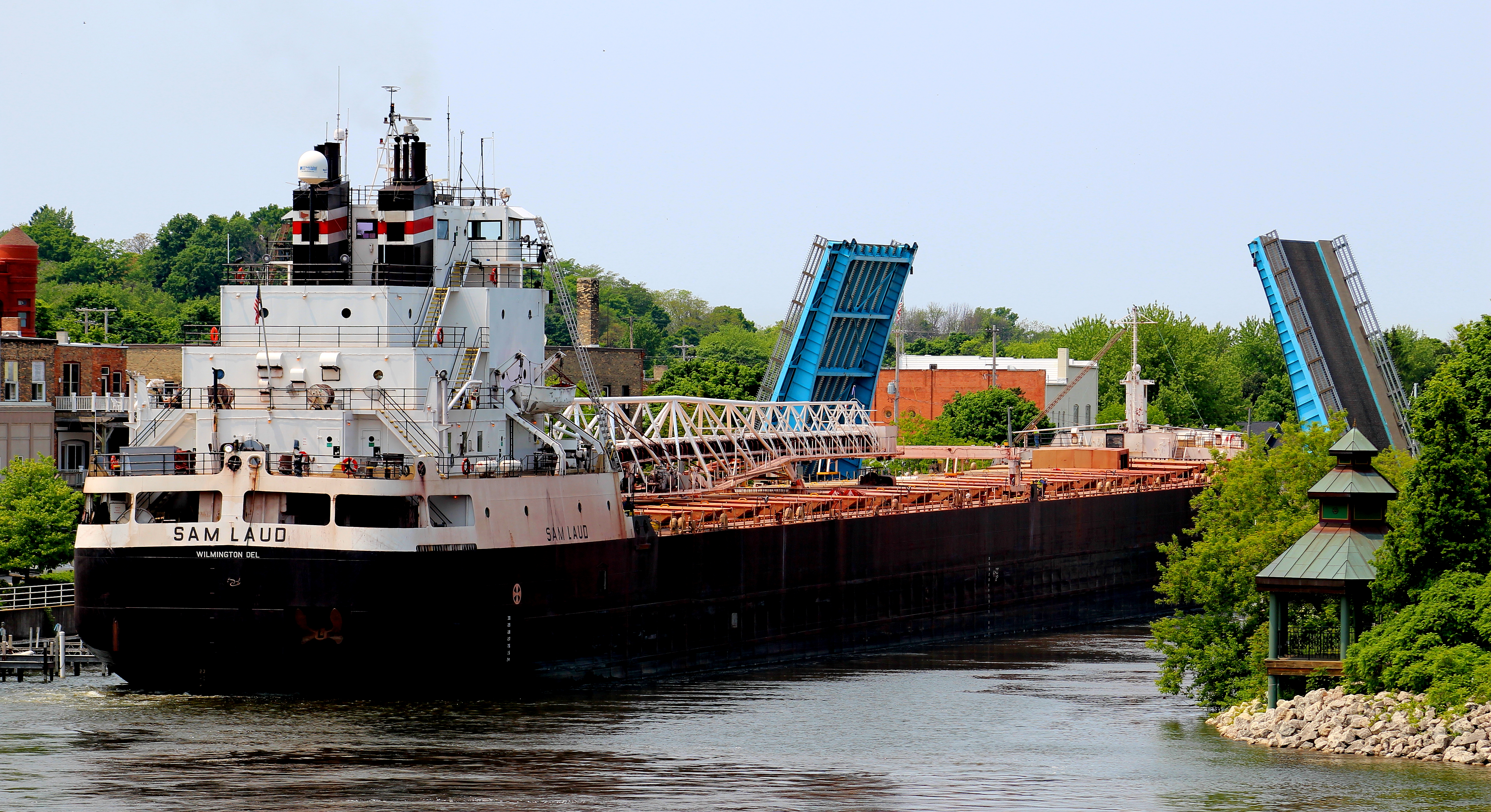 Freighter Sam Laud is seen navigating through Maple Street bascule bridge in the Manistee River Channel