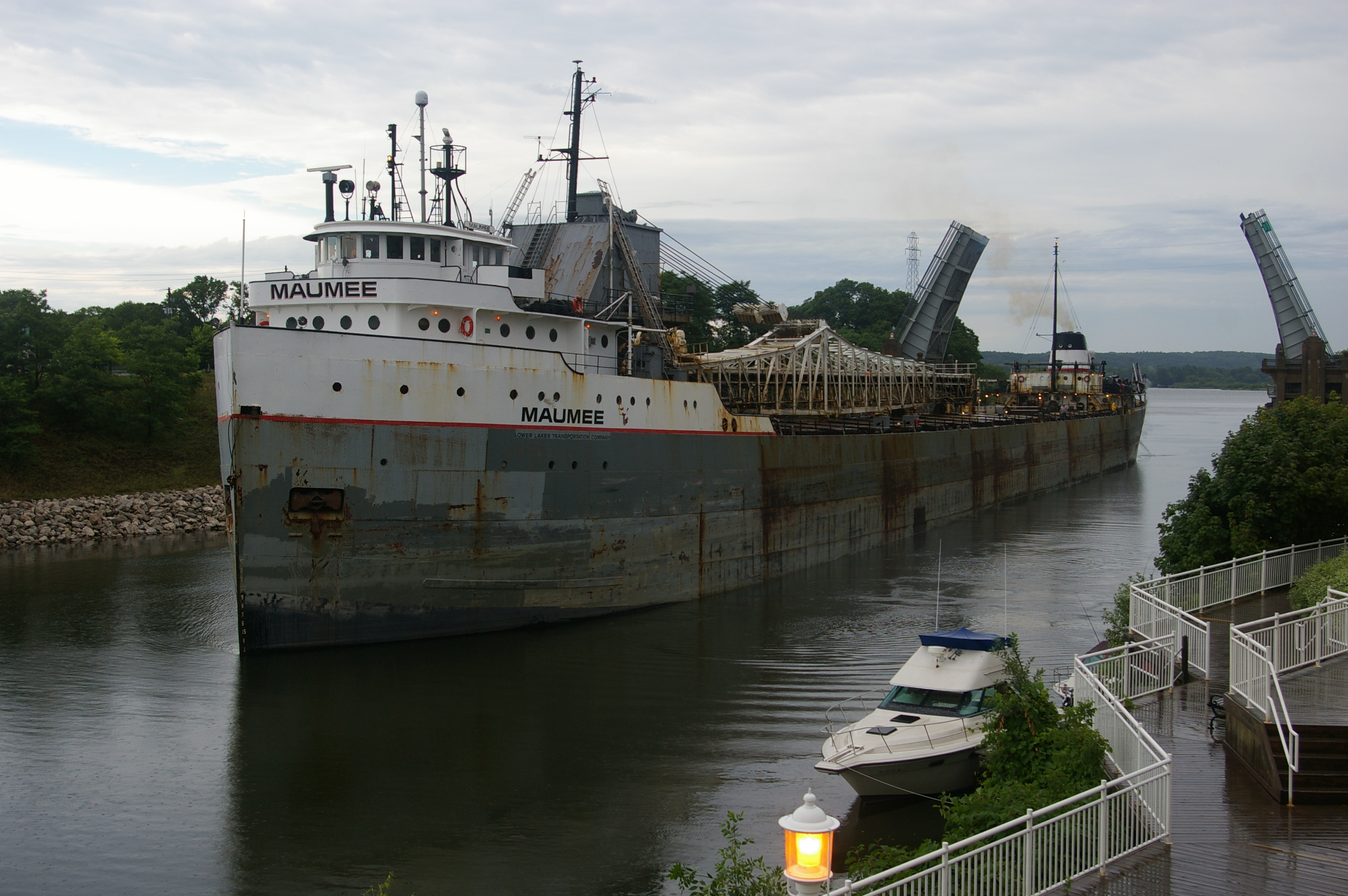 Great Lakes Freighter Maumee in the Manistee River Channel as it goes through the US 31 Bridge