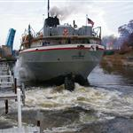 Freighter Calumet in Manistee River Channel maneuvering a bend in the river as seen by the water churning near the propeller