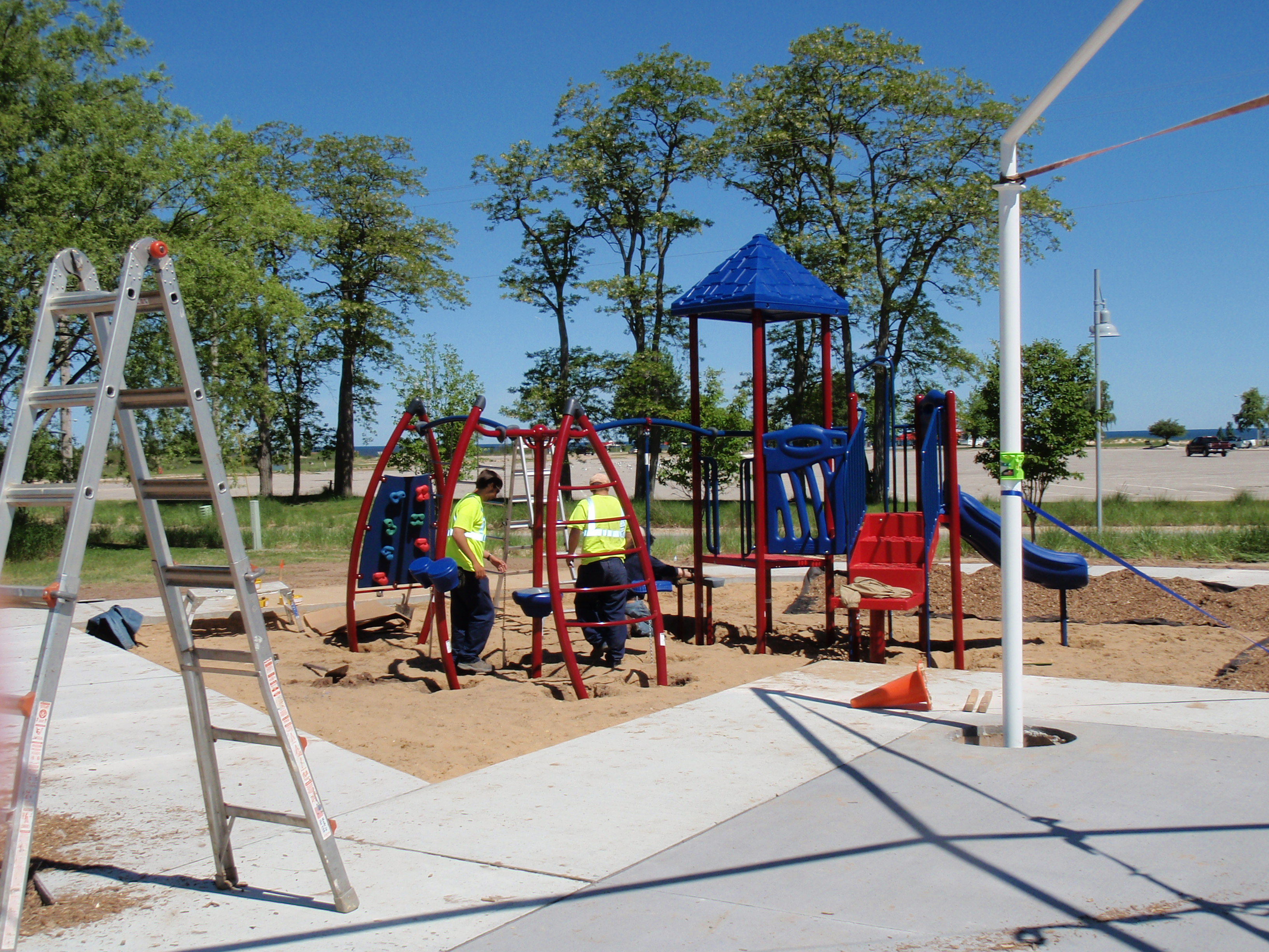 Volunteers are installing components of the small slide and climber during the community build of Rocket Park