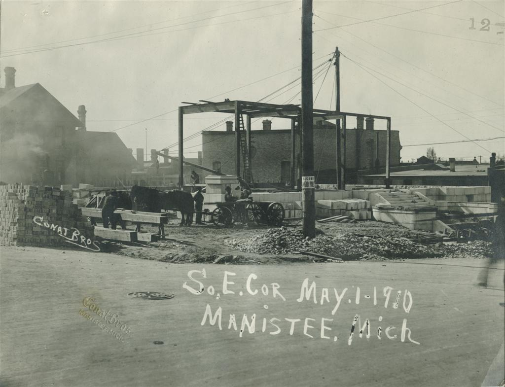 Construction in progress May 1910 historical photo of site activity with workers, horses and equipment as they begin work on the front steps