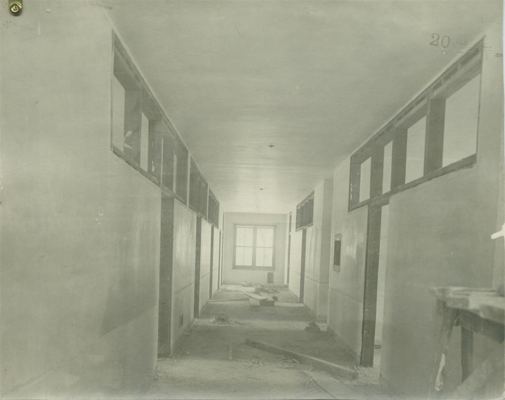 Historical photo showing the second floor Interior  plaster in place, transom windows and door frames in place