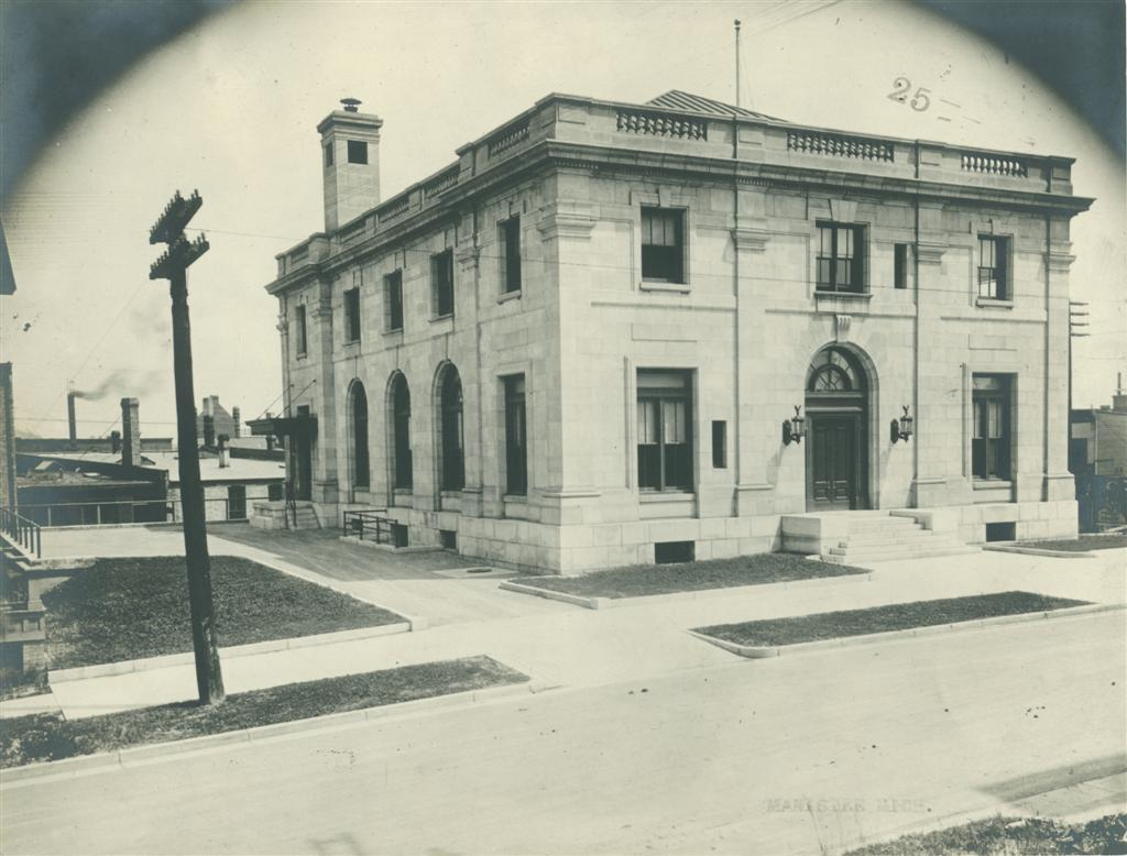 Last Historical Photo of the construction of the Post Office in this picture the building is complete and it shows a beautiful limestone building that will be a part of the history of Manistee for over 100 years