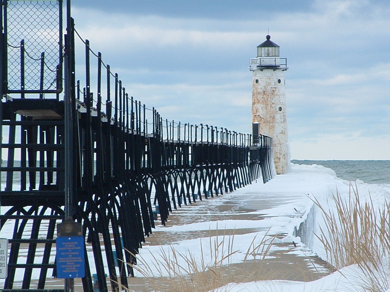 great view of the catwalk and Lighthouse at Fifth Avenue with snow on the pier taken in 2013