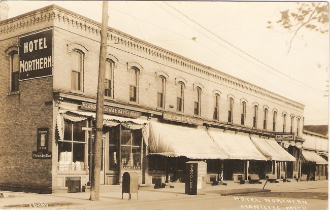 Historical photo of Hotel Northern located on Washington Street with canvas awnings hanging over is the sidewalk