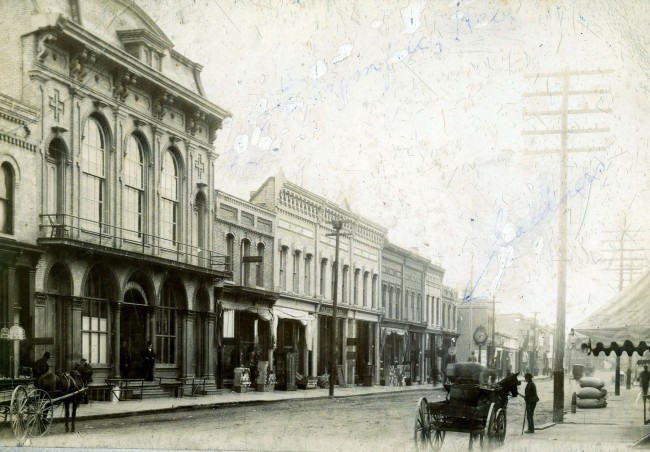 Looking Southwest on River Street circa 1890 horses and carts are seen in the photo with the Haley Sisters Building  and A.H. Lyman Store