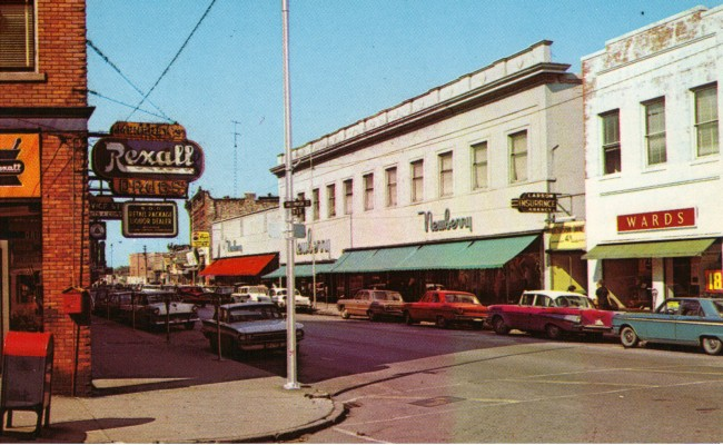 The Newberry buildign is the focal point of this 1960's colored postcard of River Street looking west on River Street cars are parked along the streets