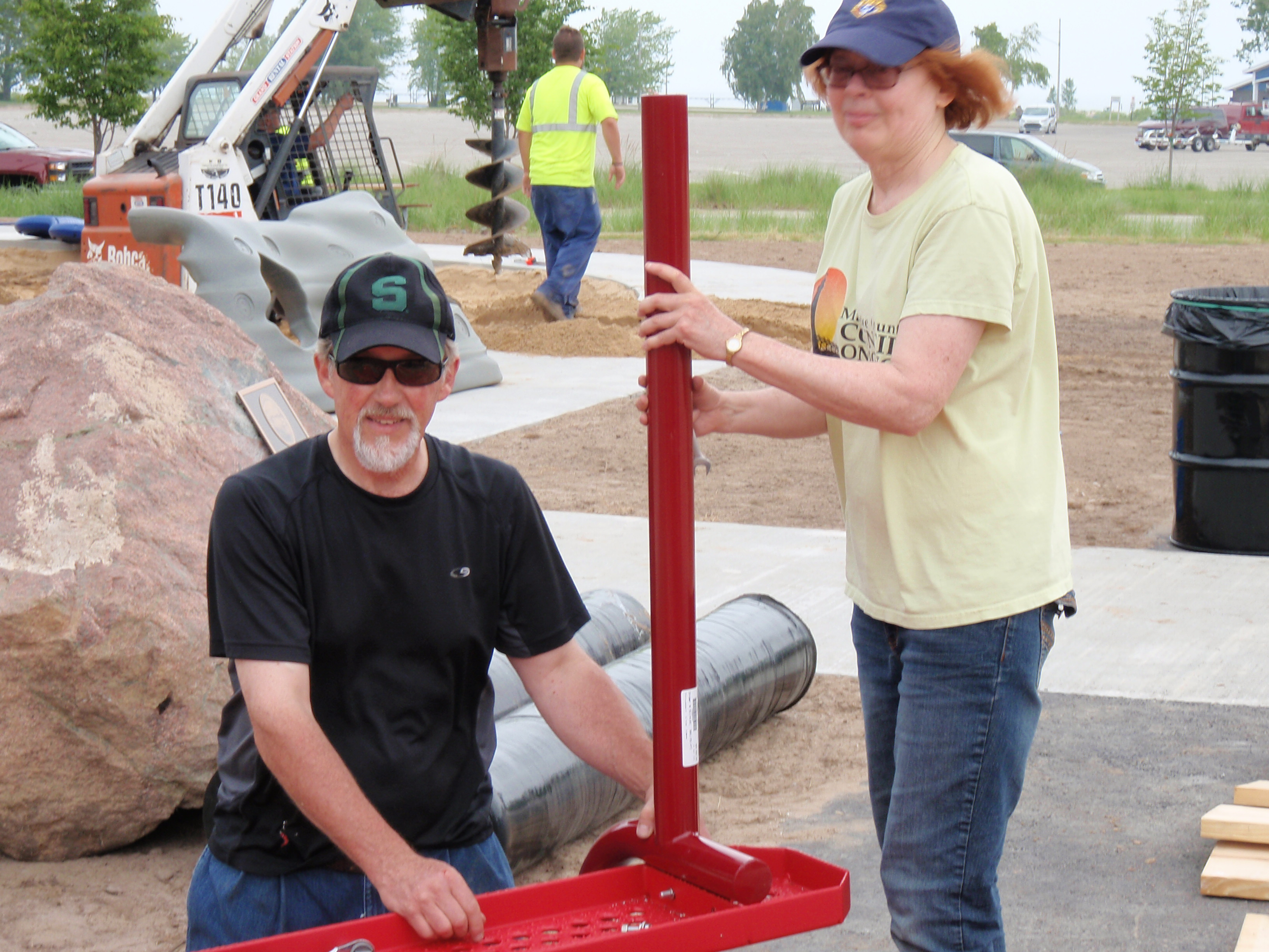 Volunteers begin constructing playground equipment and holes are being drilled for the community build of Rocket Park